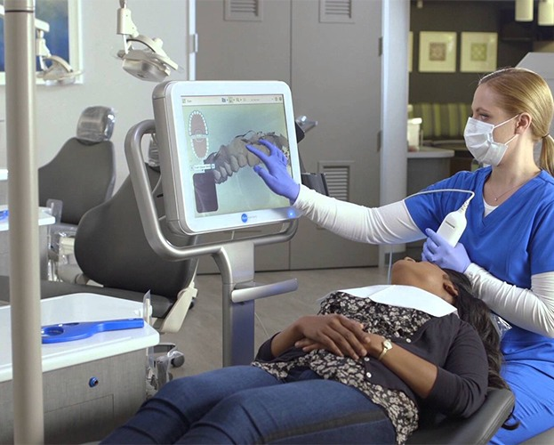 Dental team member capturing iTero intraoral scans of patients' smile