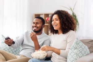 people smiling and eating popcorn